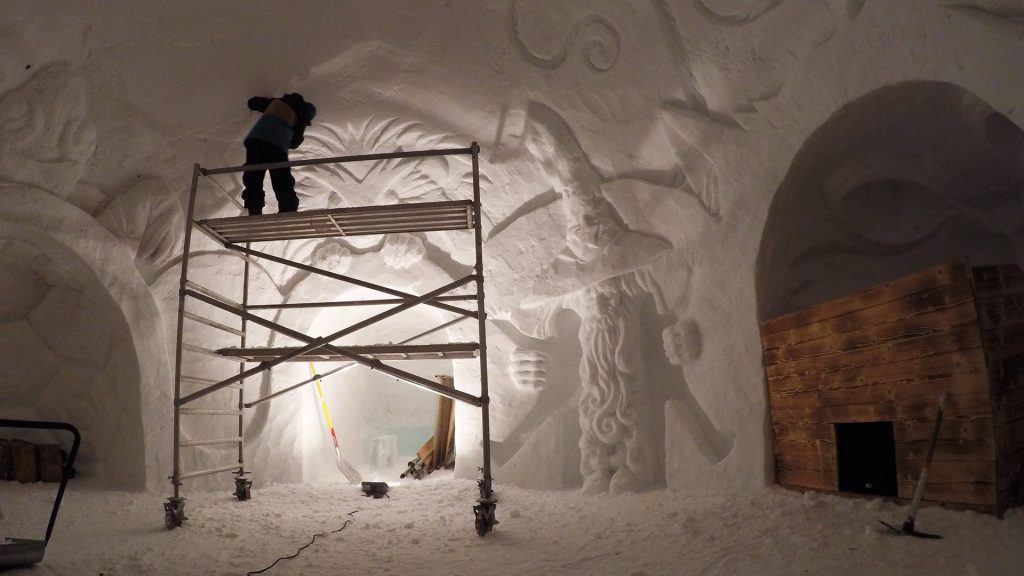 Snow sculptor working